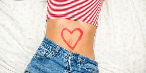 Woman stomach with heart drawing