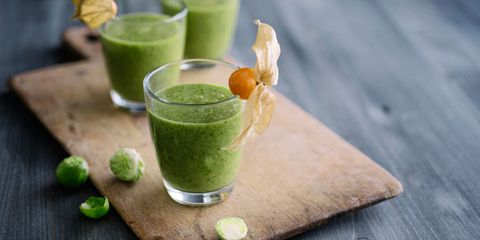 Green juices on chopping board table