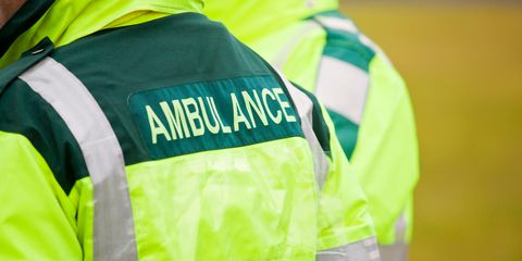 Two UK Ambulance paramedics in attendance at an outdoor event.