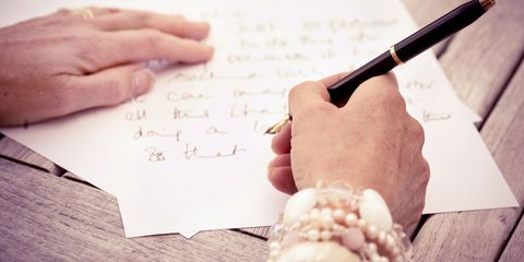 Womans hands writing letter close up
