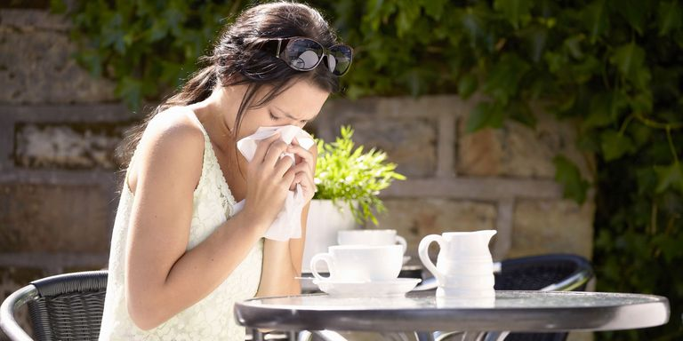 Woman suffering from hay fever