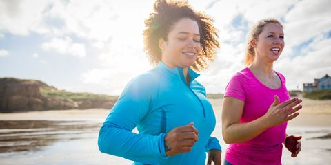 Women running together in the sun