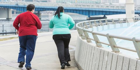 Two overweight people running