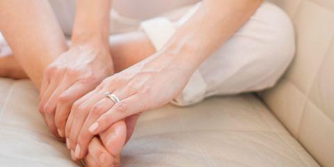Woman rubbing painful foot