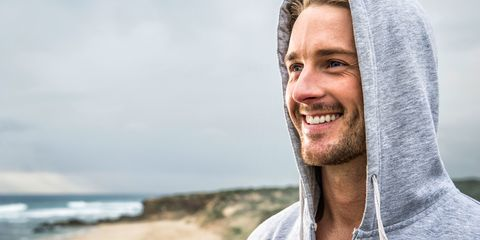 Healthy man smiling at the beach