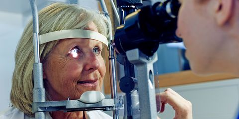 Female patient having eye tested in hospital