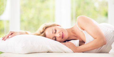 Sleeping woman smiling