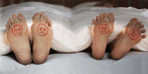 Sad feet end of bed couple