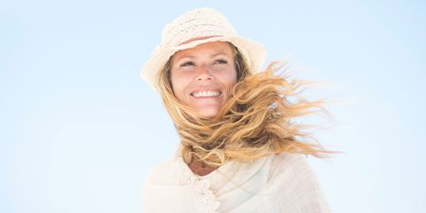 Smiling blonde woman at the beach