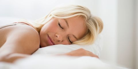 Woman fast asleep in bed