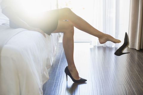 Businesswoman kicking off her high heels