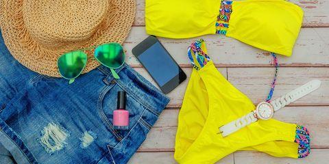 Holiday suitcase - bikini, nail varnish, sun hat