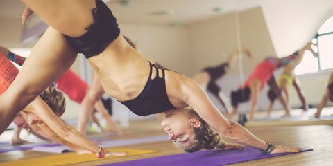 Woman doing hot yoga class