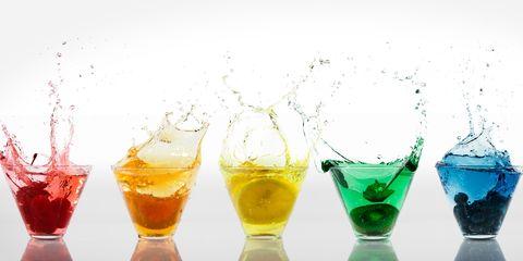 Rainbow coloured drinks in a row