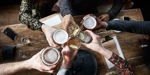 Friends toasting in pub with drinks