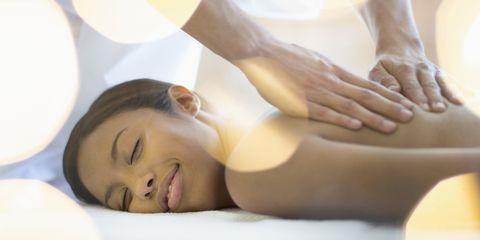 Woman receiving rolfing massage