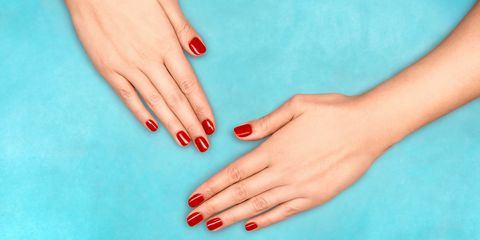 Manicured red nails