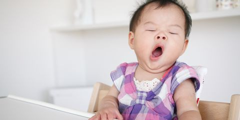 Cute small baby yawning