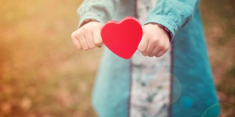 Girl holding out heart