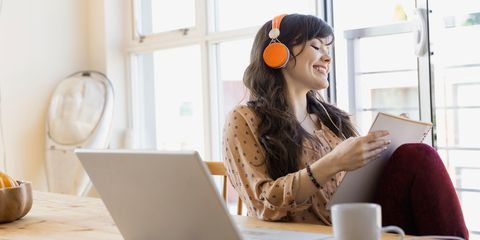 Woman working listening to music headphones