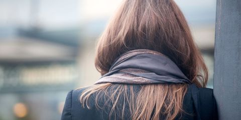 Rear view of woman with long hair wearing a scarf