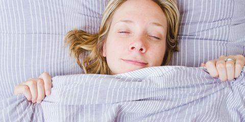 Woman having good night's sleep