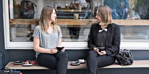 Two women drinking coffee together