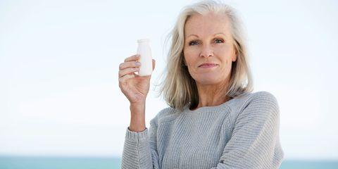 Woman taking probiotic