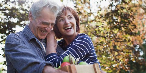 Senior couple outside apple picking