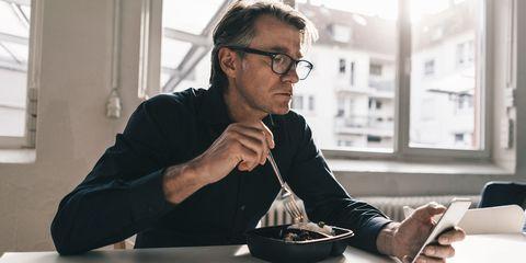 Man eating alone at desk