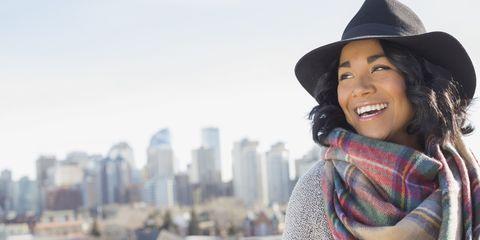 Happy woman looking away outdoors