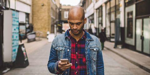 Bald man on phone