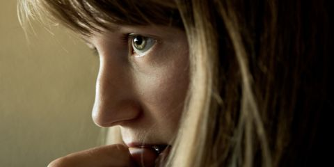 Young woman's nervous concentration