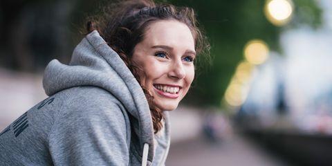 Portrait of happy female runner taking a break