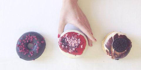 Womans hand reaching for doughnuts
