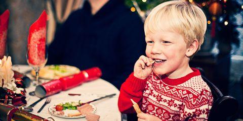 Young boy eating Christmas dinner
