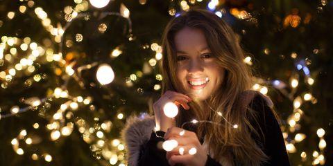Woman with Christmas lights