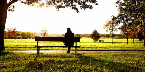 Man sat on bench in park PTSD