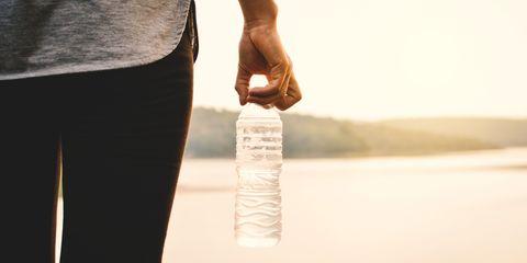 Woman exercising holding water bottle