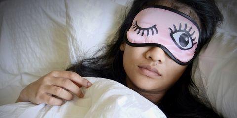 Woman sleeping using eye mask