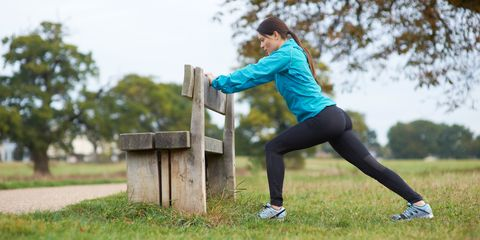 Stretching workout park bench