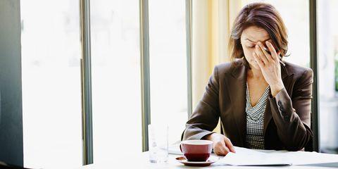 Anxious woman in coffee shop