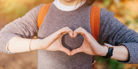 Girl making heart shape with her hands