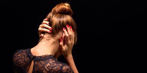 Woman covering ears back shot