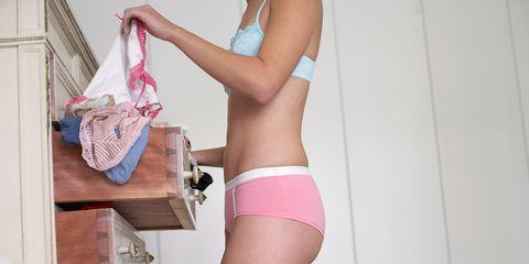 Woman looking through underwear drawer