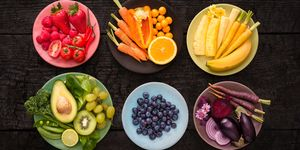 Bowls of fruit and vegetables colour co-ordinated