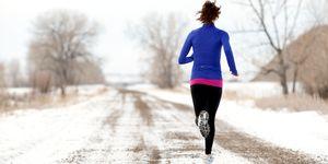 Woman running in snow winter