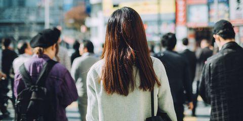 Woman in crowd back of head