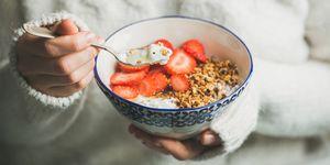 Yoghurt strawberries granola breakfast bowl