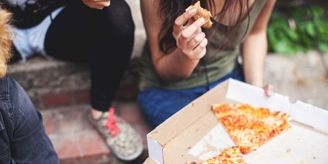 Eating pizza with friends outside